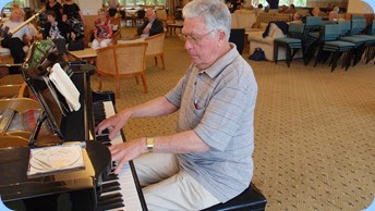 Jim Nicholson playing the grand piano making it look consumately easy! Photo courtesy of Dennis Lyons.