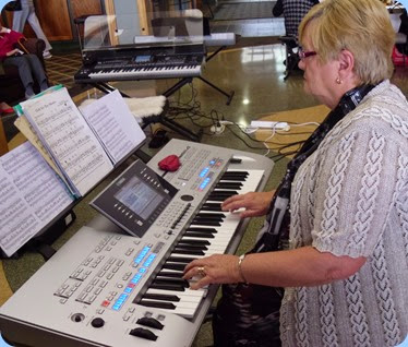 Barbara McNab playing her Yamaha Tyros 4.