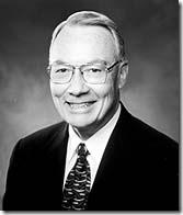 Dennis E. Simmons.
