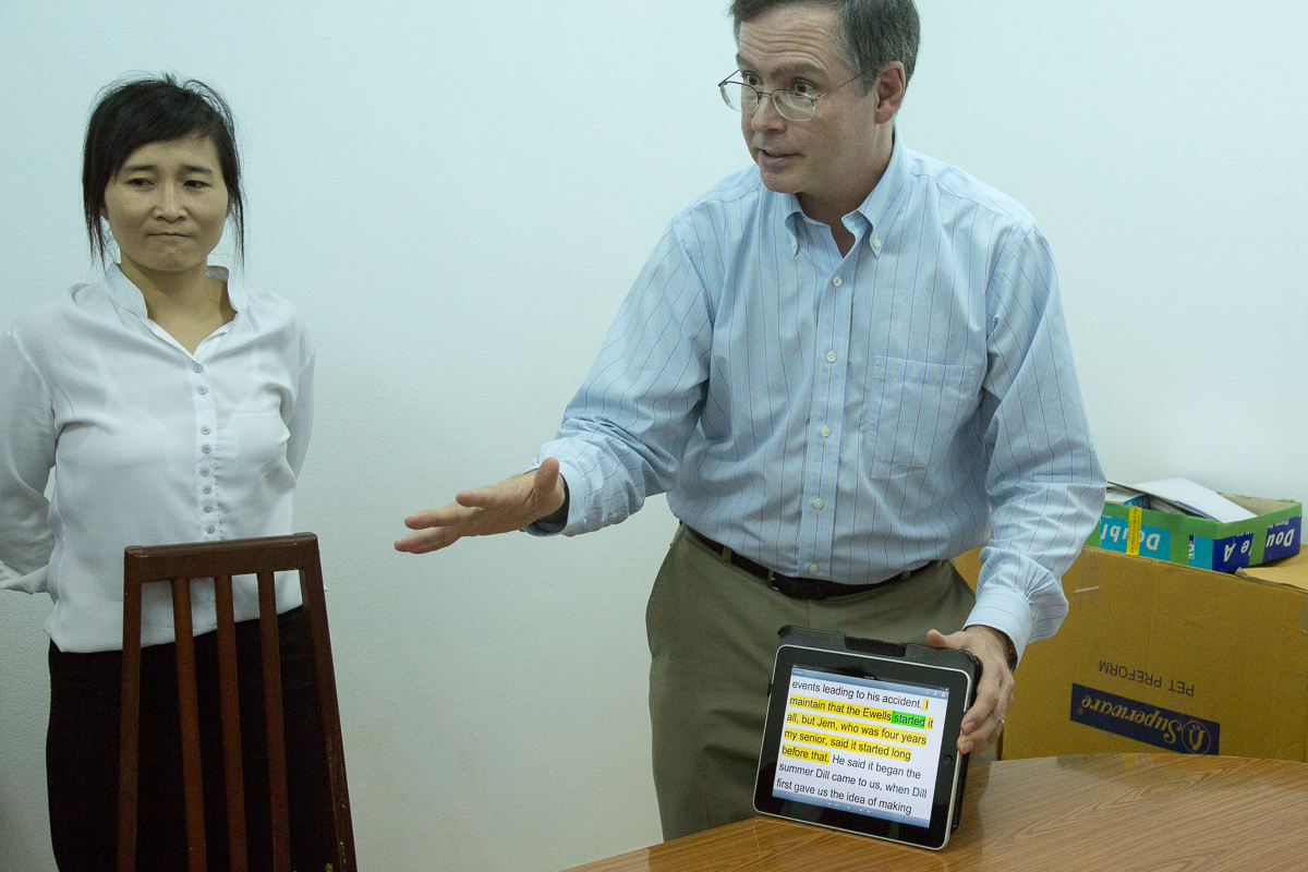 Phab watched Jim demonstrate software on an iPad.