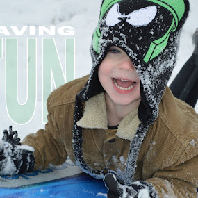 Having Fun by Shannon Maltbie-Davis - Typography Captioned Photos ( marvin the martian, having fun, caption, sled, winter, sledding, snow, smile, toddler, typography, boy, boots, stocking cap,  )