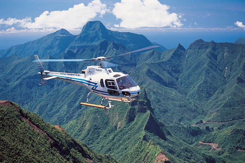 Helicopter tours over Tahiti allow visitors to view the scenic landscapes from a bird's eye view.