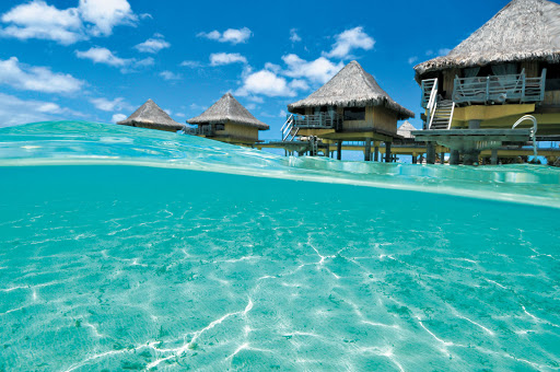 Moana_Bora_bungalows_lagoon - The Paul Gauguin takes you to InterContinental Le Moana Bora Bora, where distinctive bungalows perch above the water and offer the ultimate island escape.