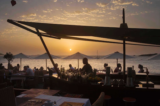 cafe-Ibiza-Spain - Locals and visitors indulge in Mediterranean fare served at a taverna on the island of Ibiza, in the Mediterranean off the coast of Valencia in eastern Spain at Sun Sea Bar.