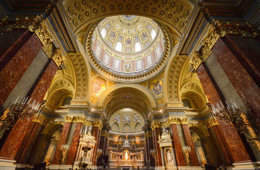 Inside ornate St. Stephen's Basilica in Budapest, Hungary. See it on a river cruise down the Danube.