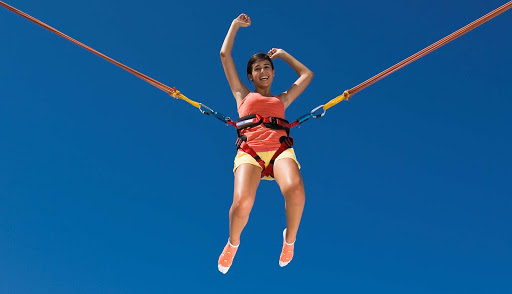 Enchantment-of-the-Seas-bungee - For exhilarating fun, teens, children and adults can try out a bungee jump trampoline at Enchantment of the Seas' Jump Zone.