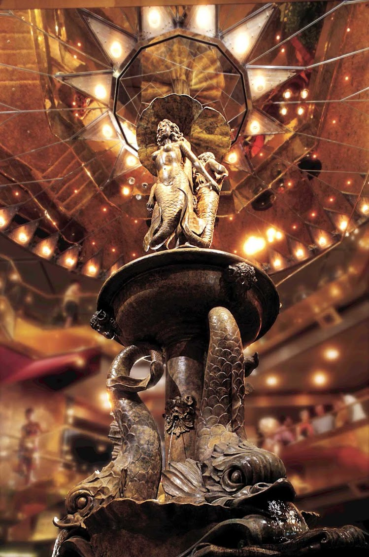 """The Statendam of Holland America Line showcases an elaborate 26-foot-high sculpture titled """"Fountain of the Siren"""" at the center of its three-story atrium."""