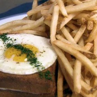 Croque Madame, Sauce Mornay (toasted Ham And Cheese Sandwich With A Fried Egg And Mornay Sauce)