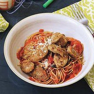 Sliced Sausages over Spaghetti with Tomato-Basil Sauce.