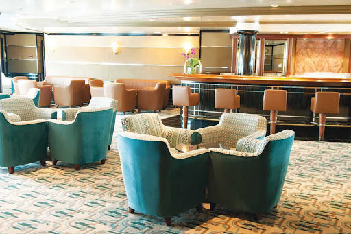 Silversea_bar_lounge2 - The bar aboard Silver Shadow offers guests live music, a dance floor and complimentary cocktails. Swing by to chat, mix and mingle.