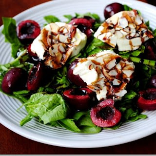 Almond-Crusted Warm Goat Cheese Spinach Salad with Cherries