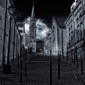 by Andrew Percival - Buildings & Architecture Public & Historical ( clouds, sky, black and white, vintage, clock tower, clock, old town, buildings, architecture, alley )