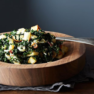 Caesar-Style Kale Salad with Roasted Onions and Ricotta Salata.