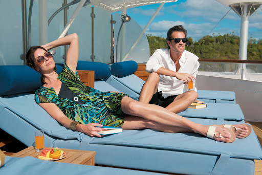 Tere-Moana-Balinese-beds - Enjoy a fresh fruit plate while taking in the sights from a  Balinese bed on the sundeck during a sailing on the ship Tere Moana from Paul Gauguin Cruises.