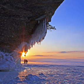 Sunset at the Caves by Jamie Rabold - Landscapes Sunsets & Sunrises ( caves sunset, ice caves, wi, south shore, into the sun, lake superior, apostle shores, people,  )