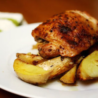 Maple-Mustard Baked Chicken Thighs with Potato Wedges.