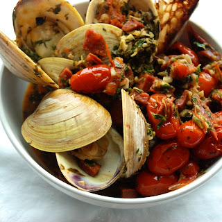 Clams with Grilled Chorizo & Charred Tomatoes.