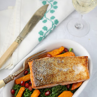 Pan-fried Salmon On Kale, Sweet Potato And Pomegranate
