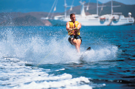 Windstar-Cruises-waterskiing - Try your hand at waterskiing or one of the other water activities — kayaking, sailing, snorkeling, boat rides along the coast — during your Windstar sailing.