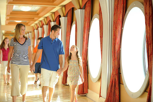 Disney-Dream-Guests-in-Hallway - You'll find plenty of space to explore on Disney Dream, which features 1,250 staterooms, 3 swimming pools, 4 whirlpools, live shows in a 1,340-seat theater — and no casinos.