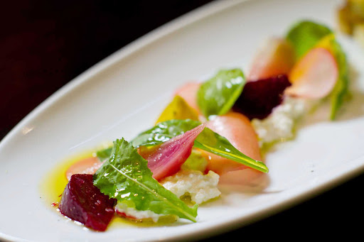 150-Central-Park-Royal-Caribbean-appetizer-2 - A goat cheese, beets and micro-greens salad served at Oasis of the Seas' 150 Central Park restaurant.