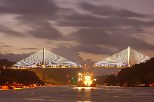 Panama-Centennial-Bridge - The Centennial Bridge, which crosses the Panama Canal near the Pedro Miguel locks, shimmers in the twilight.