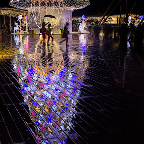 Christmas Rhythm in the Falling Rain by Sherry Zhao - Public Holidays Christmas ( holiday, lowlight, colorful, happy, christmas, night, mood factory, vibrant, happiness, January, moods, emotions, inspiration, city at night, street at night, park at night, nightlife, night life, nighttime in the city )