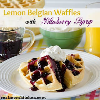 Lemon Belgian Waffles with Blueberry Syrup.