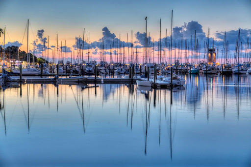 Fishing at sunrise at the pier in St. Petersburg, Florida.