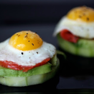 Quail Egg Canapés with Smoked Salmon, Avocado and Pickled Cucumbers.