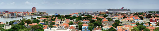 Carnival-Breeze-Curacao - Carnival Breeze sails off the coast of the colorful Caribbean island of Curaçao.