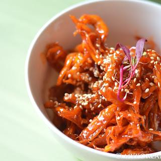 Ojingeochae Muchim 오징어채 무침 (Spicy Squid Strips).