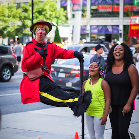 The Floating Clown by J Delos Santos - People Street & Candids ( clown, red jacket, floating, busker, levitate, floating clown, street performer, red coar,  )
