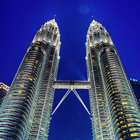 Towering by Sanjeev Goyal - Buildings & Architecture Architectural Detail ( twin, towers, petronas, malaysia, night, , city at night, street at night, park at night, nightlife, night life, nighttime in the city )