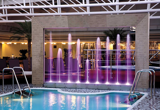 Holland-America-Signature-Class-Lido-Pool-Midship-evening - The Lido Pool at midship on Holland America's Eurodam features nine purple fountains that light up at night.