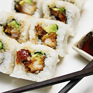Eel & Avocado Inside-Out Roll with Shrimp Tempura and Eel Sauce.