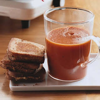 Smoky Tomato Soup with Grilled Cheddar Cheese.