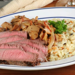 Sizzling Steaks with Creamy Rice Primavera.