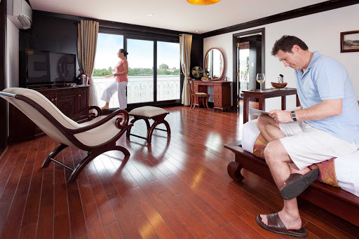 AmaLotus-Luxury-Suite-Bedroom - Spread out in a 624-square foot luxury suite aboard AmaLotus with a décor that combines colonial elegance with regional Khmer accents. The suites feature large sitting areas, air-conditioning, mini-bar, safety deposit box and a luxurious bathtub.