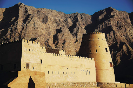 Khasab_Fort_Oman - Seabourn ships sail the warm waters of the Arabian Sea to historic countries like Oman. A surprise jewel is Khasab Fort, a pretty stone fort built by the Portuguese in the 1600s. Ancient towns such as Khasab offer a compelling glimpse into the essence of Arabia.