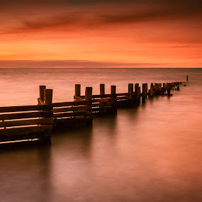 Sunset Reflection on Still Waters by Jan Murphy - Landscapes Sunsets & Sunrises ( water, tranquil, groyne, red, relax, sunset, long exposure, tranquility, relaxing,  )