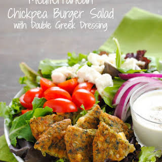 Mediterranean Chickpea Burger Salad with Double Greek Dressing.