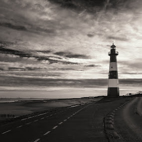 Lighthouse by Dominic Schroeyers - Black & White Landscapes ( clouds, black and white, lighthouse, sea, road, beach, breskens, netherlands )