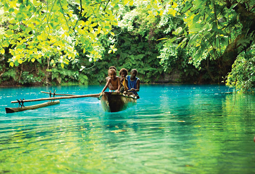 Kids-Locals-Blue-Hole-Vanuatu - Visit the Blue Hole when you sail to Espiritu Santo, the largest island of Vanuatu, Melanesia, with Silver Discoverer.