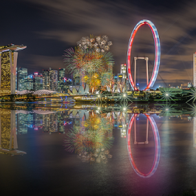 Fireworks - Reflection by GokulaGiridaran Mahalingam - Buildings & Architecture Public & Historical ( reflection, national day parade, tall buildings, ndp, national day, blast, cityscape, singapore river, city, colours, lotus, buildings, mbs, fireworks, singapore flyer, bridges, financial centre, asm )