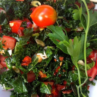 Kale and Spinach Salad with Tomatoes and Garlic.