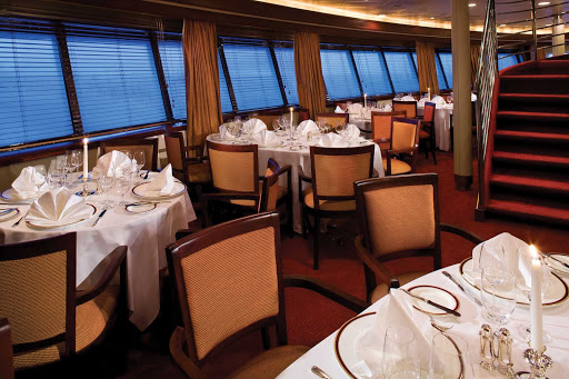 Silver_Explorer_dining_room_3 - The main dining room on Silver Explorer is sure to impress with its classy crystal, silver and candlelight.