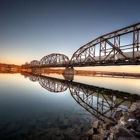 Twin Bridges by Bob Grandpre - Buildings & Architecture Bridges & Suspended Structures ( water, trans, missouri, expansion bridge, arch, sunset, bridges,  )