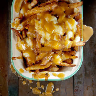 Poutine (French Fries with Gravy and Cheese Curds).