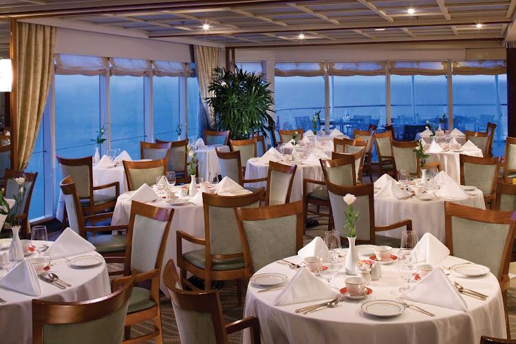 Dine in  La Veranda Restaurant to enjoy regional specialties while appreciating the view as you sail aboard Seven Seas Mariner.